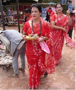On their way to perform a ritual: women in sari