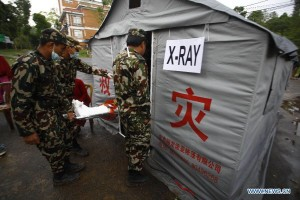 Chinese medic-camp in Dhulikel - but countless villages must pool their own resources.
