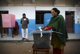 Soon twenty years ago since the last local election in Nepal: woman casting a vote