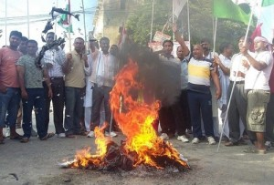 Protesters burning copies of the draft constitution while local economy is losing millions every day