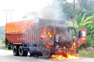 When trucks defy the roadblocks and get caught: torched by bandh enforcers in Saptari