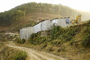"""Many students are down with the cold"", says local principal, Ramji Shrestha, at typical TLC built of tin sheets in Ramechap."