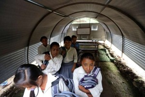Post-quake, many students are left to study in tin shelters or under tarpaulins